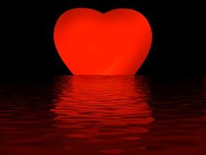 Rotes Herz versinkt im Wasser